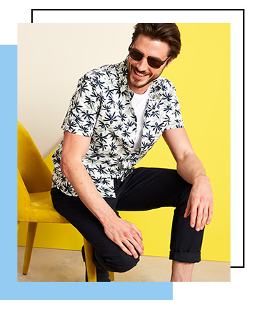 Made from 100% cotton, this casual shirt is designed with an all-over palm-tree print