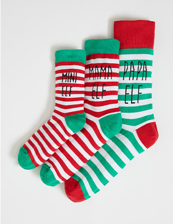 Matching adult and child striped socks with 'Mini elf', 'Mama elf' and 'Papa elf' slogans