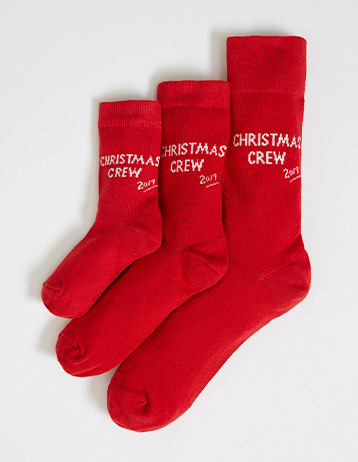 Matching adult and child red socks with 'Christmas crew' slogan