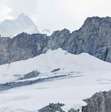 Video of woman modelling in cream longline crinkle padded coat on mountainside