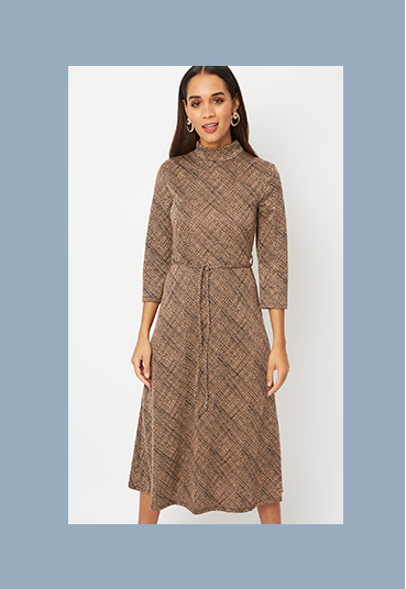 Woman in brown crosshatch high neck midi dress