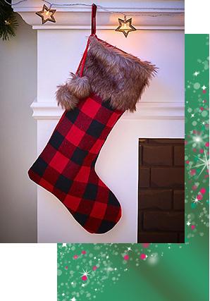 Red tartan stocking hanging on a fireplace