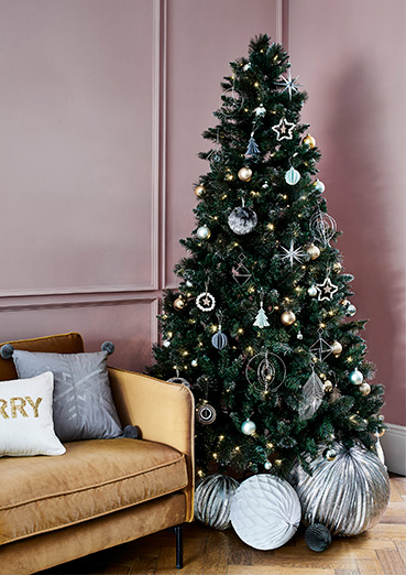 Christmas tree designed with silver and white baubles with silver decorations underneath