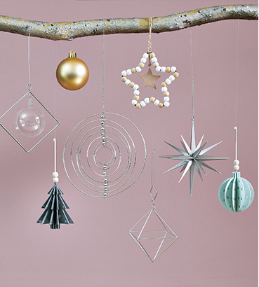 Christmas decorations and baubles hanging on a branch