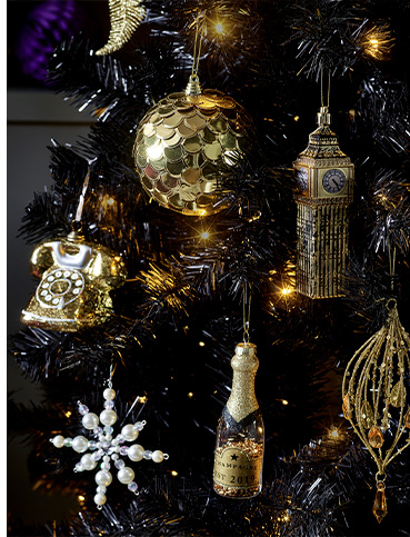 Golden baubles on a Christmas tree, including Big Ben and a telephone