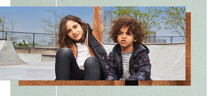 From holographic padded jackets to fleece-lined coats, discover the latest kids' coats now