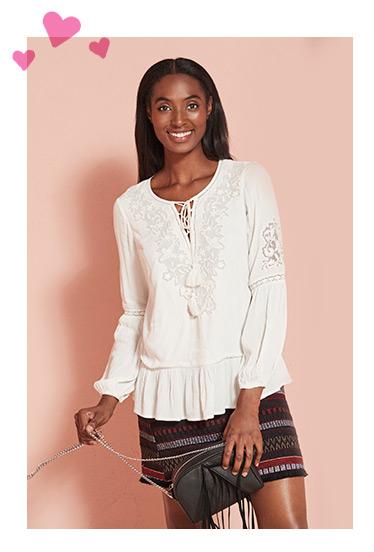 A model wearing a white blouse