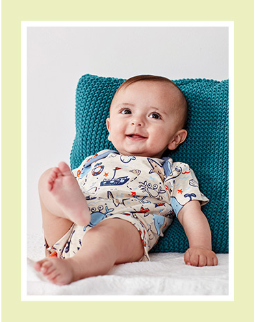 A baby in a patterned bodysuit