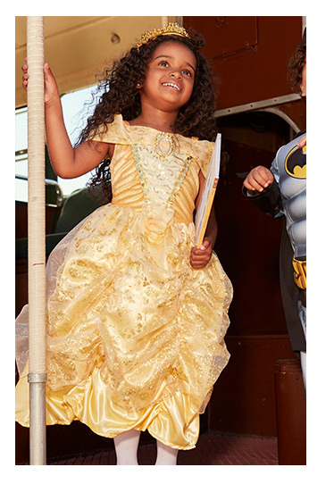 A girl wearing the Disney Princess Belle Fancy Dress Costume