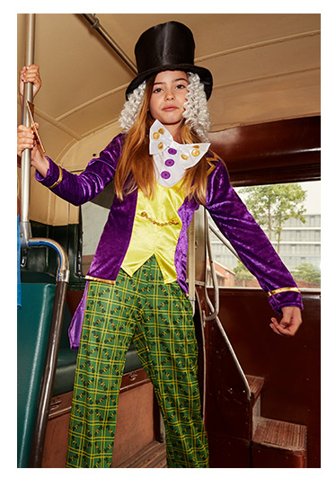 A girl wears the Willy Wonka Fancy Dress Costume