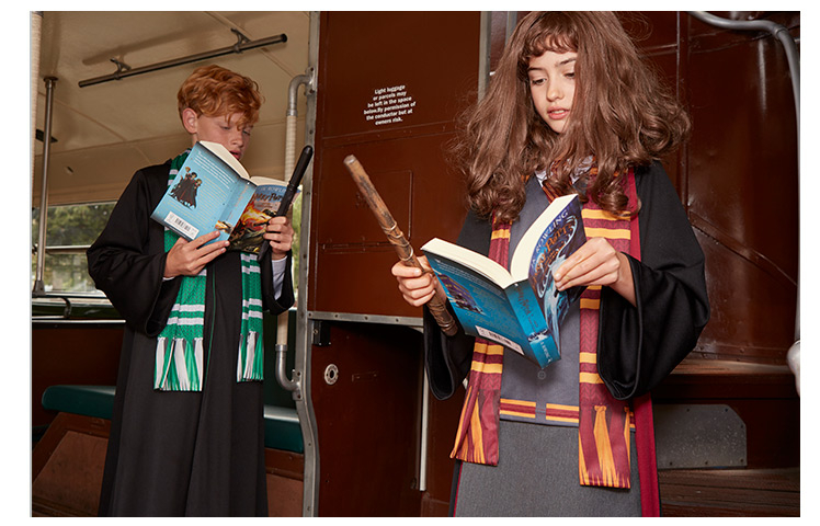A girl and boy wearing Hogwarts robes