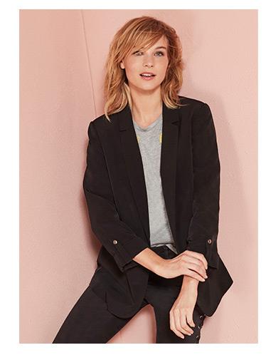 A model wears a black blazer.