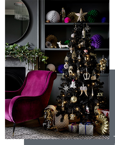 Christmas tree decorated with gold ornaments and presents underneath