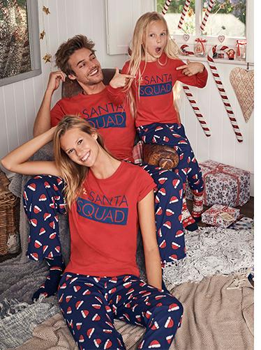 A young family wear Santa Squad pyjamas.