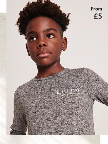 Boy wearing grey sports gear