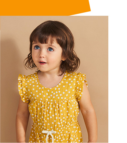 Girl wearing mustard yellow polka dot dress