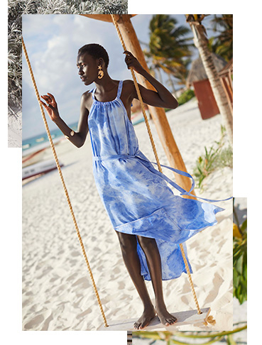 A cool blue maxi dress in a halter neck style is to dye for