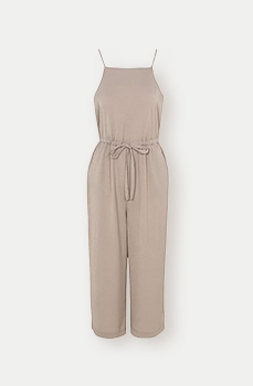 Channel head-to-toe neutrals in a jumpsuit