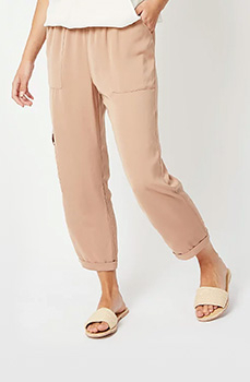 Comfortable and stylish, rock these beige utility trousers with nude sliders