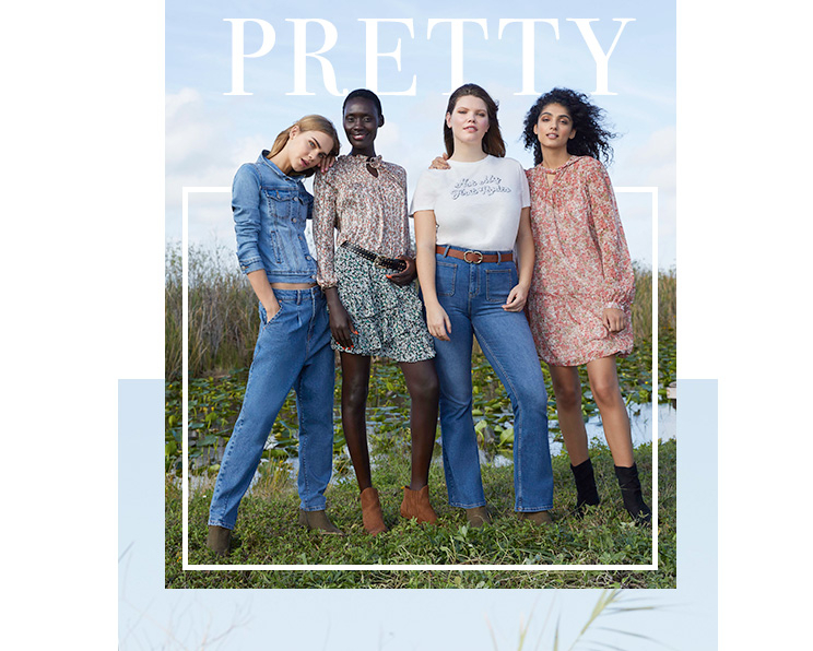 Four women in a field wearing George Pretty Western trend clothing, including a denim jacket and jeans, slogan T-shirt and jeans, floral blouse and matching skirt and floral dress