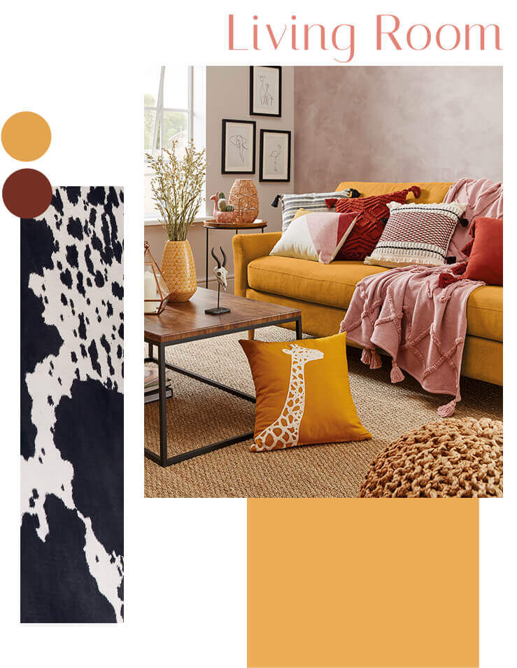 Living room with sofa with an assortment of cushions, a pink tasselled throw, wall art and tables with accessories
