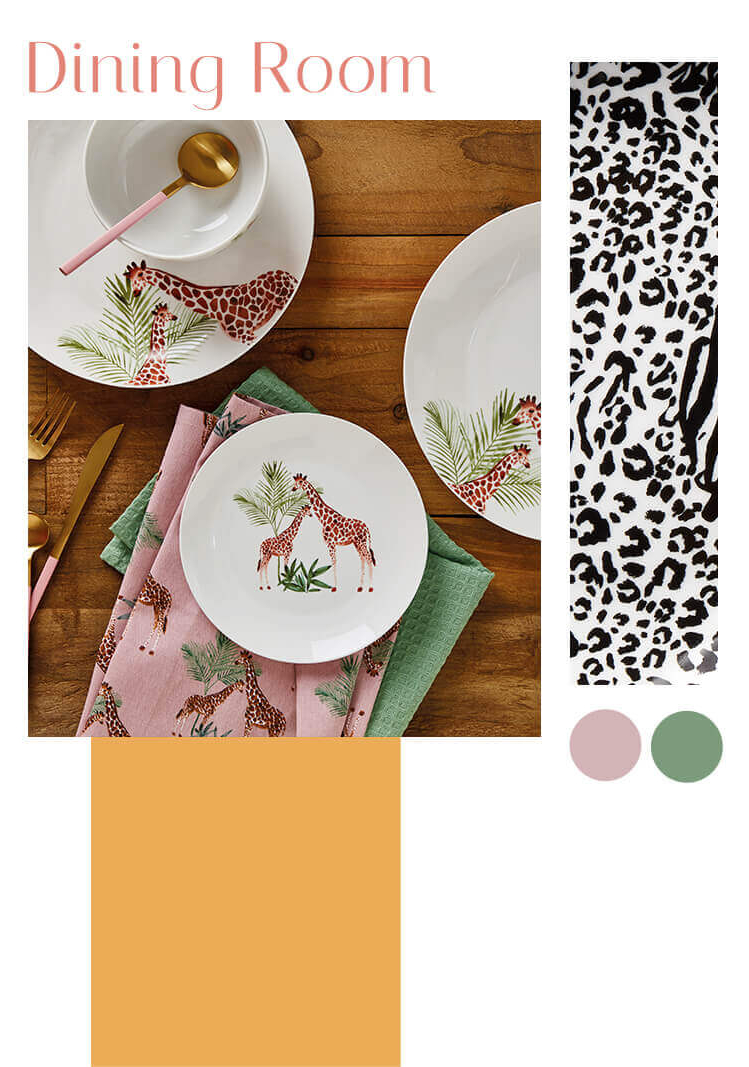 A wooden table with white crockery designed with giraffes and matching tea towels