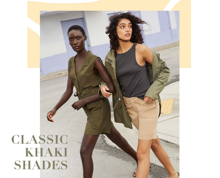 Woman wearing Khaki Button Front Sleeveless Playsuit standing with woman wearing Khaki Lightweight Hooded Parka, Chino Shorts and Black V-Neck Camisole Vest