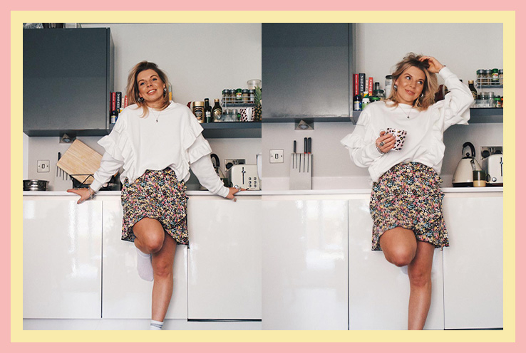 Woman wearing a white frill oversized jumper with patterned skirt