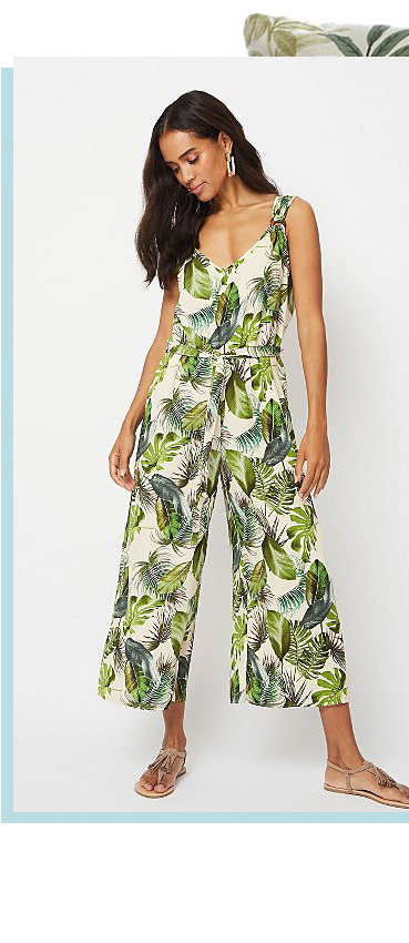 Bring the tropics with you with this green leaf print jumpsuit