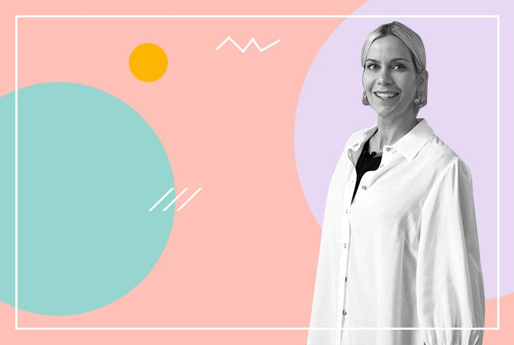 Kate Lawler in a white shirt smiling in front of a peach, turqoise and purple background