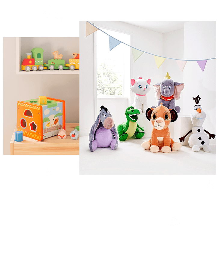 Wooden train, building set and hoops laid on top of wooden table, Disney jumbo plush toys on white floor with colourful bunting hanging in the background.