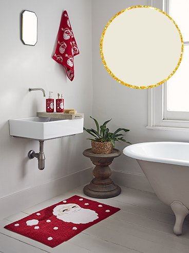 White bathroom with Christmas red and white Santa bath mat, towel, soap dispenser and tumbler set.