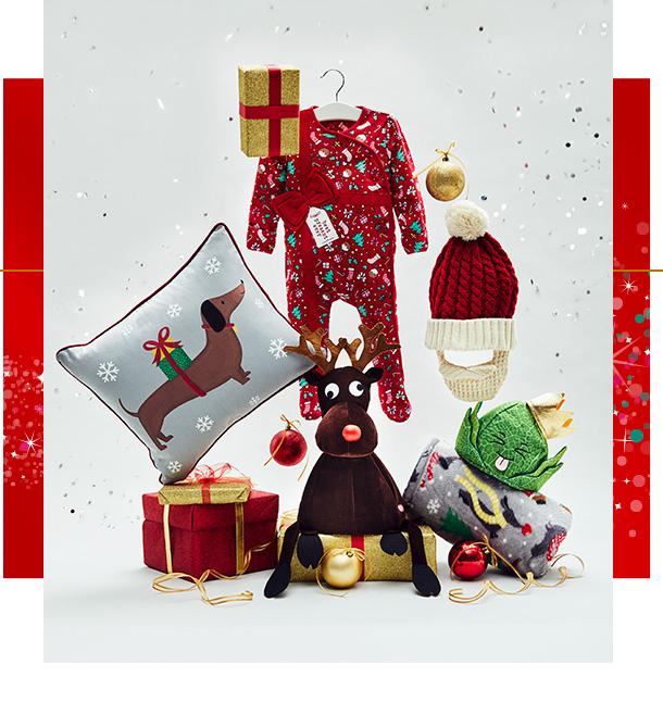 Assortment of Christmas gifts, including sausage dog cushion, festive all in one and a red Santa hat with beard