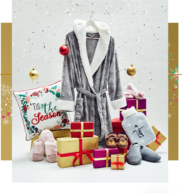 Assortment of Christmas gifts, including grey dressing gown, festive slogan cushion and a penguin hot water bottle
