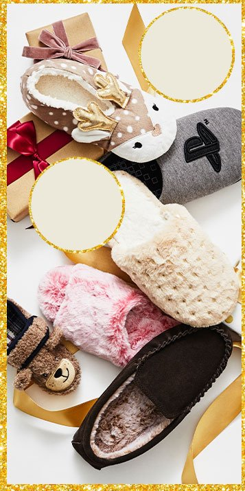 A selection of slippers on a white background surrounded by wrapped presents and festive ribbon.