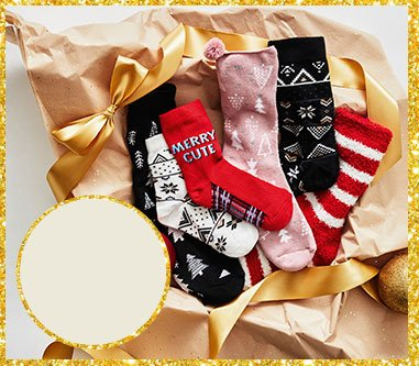 A selection of socks on brown wrapping paper and gold ribbon.