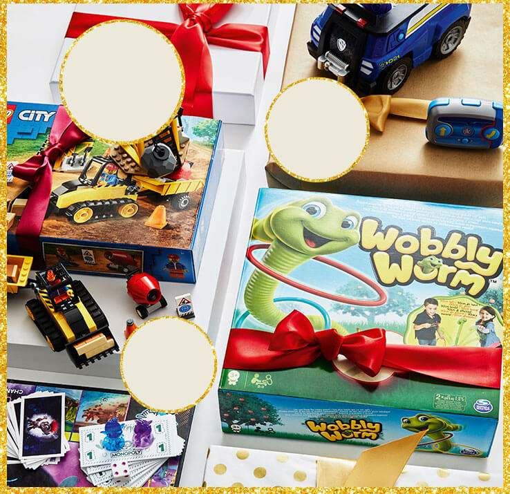A selection of family board games and kids' toys wrapped in festive ribbon.