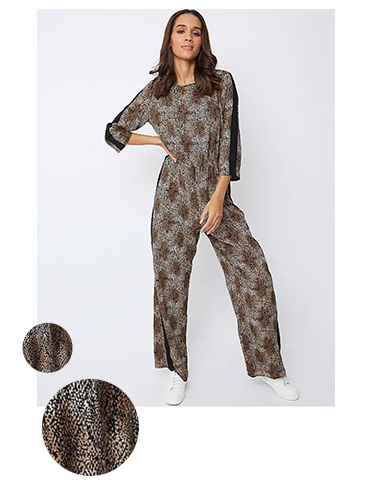 Slinky and chic day to night outfits are sorted with this snakeskin print jumpsuit paired with white trainers