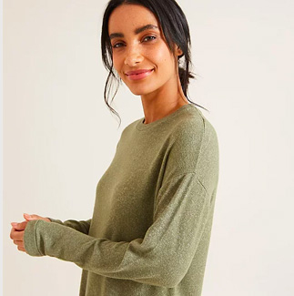 Woman wearing khaki long sleeve top