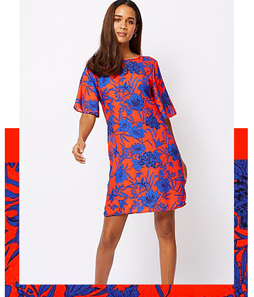 The red and blue hibiscus print of this dress is a great summer pick