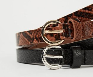 Two snake print belts on top of each other, one brown with a gold buckle and one black with a silver buckle