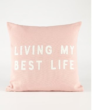 Pink cushion with a 'LIVING MY BEST LIFE' slogon