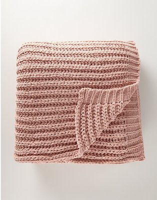 A pink knitted throw