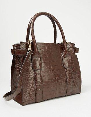 A chocolate brown patent mock croc mini tote bag