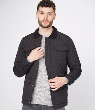 Man wearing a grey t-shirt under a black quilted cord collar jacket
