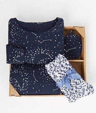 Navy pyjama set folded in a gift box.