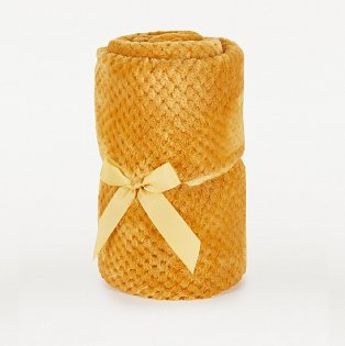 Yellow blanket tied with a yellow ribbon.