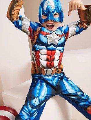Boy poses wearing Marvel Avengers Captain America Fancy Dress Costume.