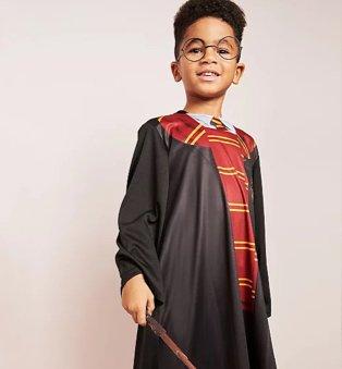 Boy poses wearing Harry Potter Fancy Dress Costume.