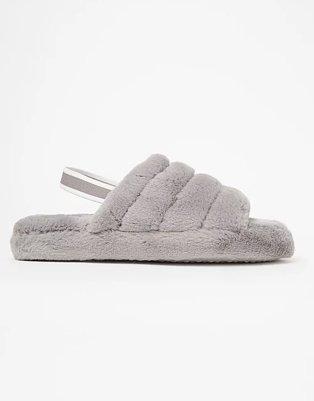 Grey chunky slingback slippers.